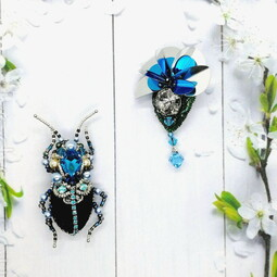 Black-blue bug and flower brooches